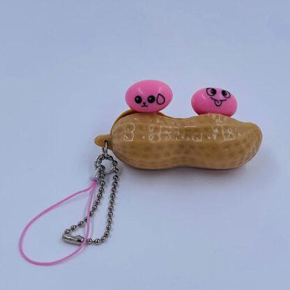 Pea Pop Peanut nøglering lyserød Fidget Toy palle.dk